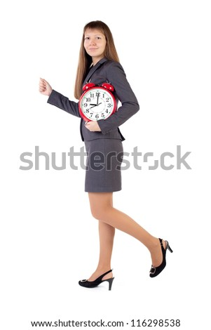 Young businesswoman holds in his hands alarm clock - stock photo