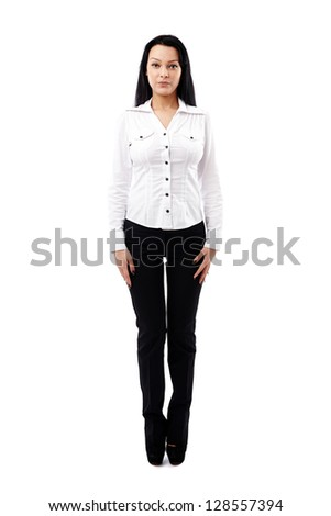 Young businesswoman in full length pose isolated on white background - stock photo
