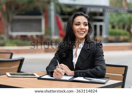 Young businesswoman in her twenties outdoors working - stock photo