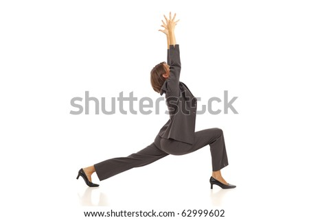 Young businesswoman in suit practicing yoga - stock photo