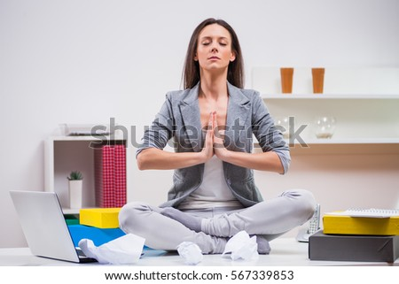 office meditation. Young Businesswoman Is Meditating In Her Office. Office Meditation