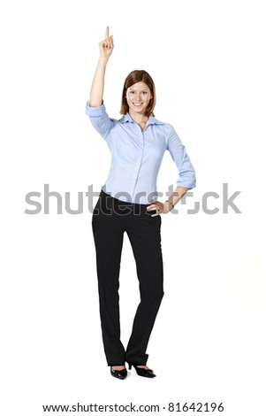 Young businesswoman isolated on a white background standing, smiling, pointing up