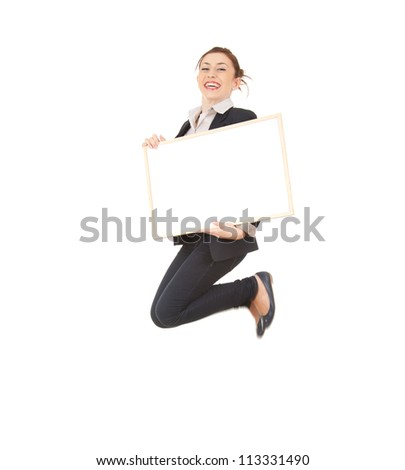 young businesswoman jumping with empty board; full length; white background - stock photo