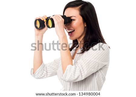 Young businesswoman keeping an eye on her team from distance. - stock photo