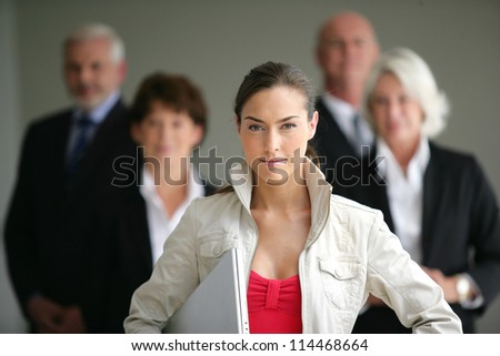 young businesswoman leader of a business team - stock photo