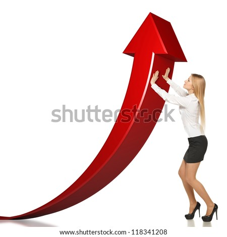 Young businesswoman lifting upwards the red arrow, isolated on white background