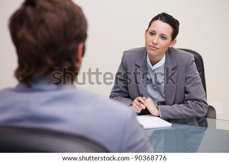 Young businesswoman listening to her business partner - stock photo