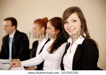 Young businesswoman looking at camera in the office. - stock photo