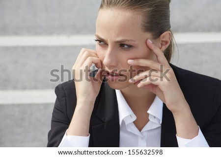Young businesswoman looking away, close up - stock photo