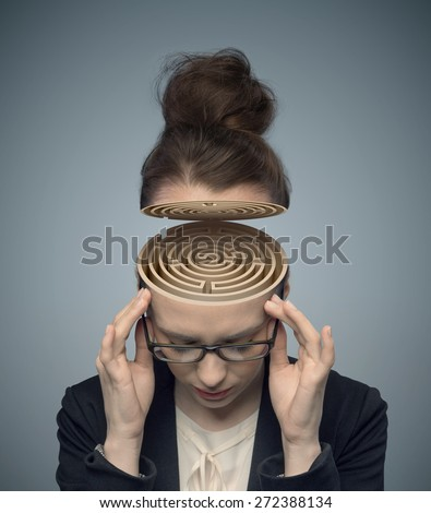 Young businesswoman looking for an idea - stock photo