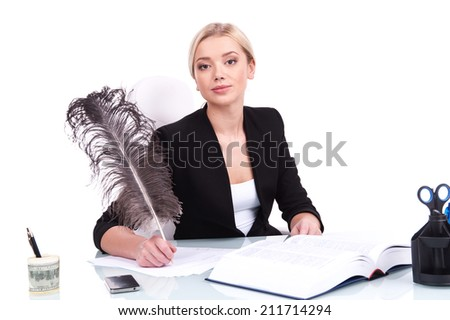 Young businesswoman looking into camera on white background. beautiful young woman writing at table using feather - stock photo