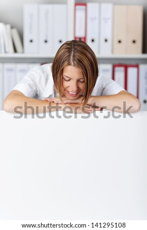 Young businesswoman looking on white board at office - copyspace for text - stock photo