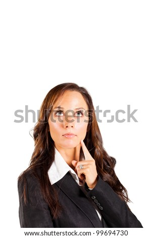 young businesswoman looking up - stock photo