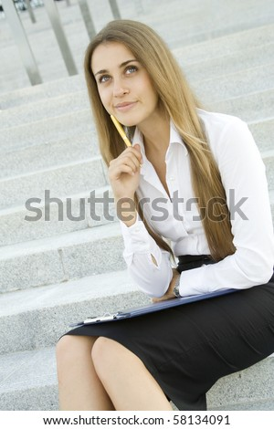 Young Businesswoman lost in thought over the signing of the document. Analyzes - stock photo