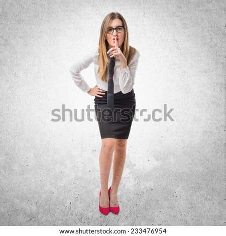 Young businesswoman making silence gesture over isolated white background  - stock photo