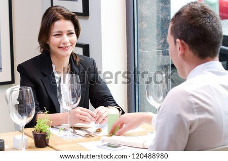 Young businesswoman on a  business meeting in a cafe