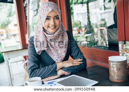 Young businesswoman on a coffee break at cafe - stock photo