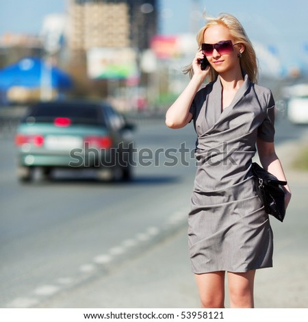 Young businesswoman on the phone. - stock photo