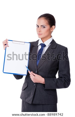 Young businesswoman pointing by pen into empty blank