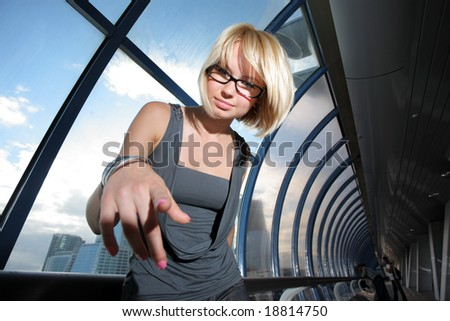 Young businesswoman pointing in camera