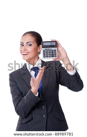 Young businesswoman pointing into calculator with 2012 text