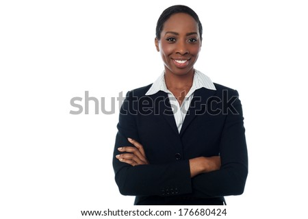Young businesswoman posing with her arm crossed