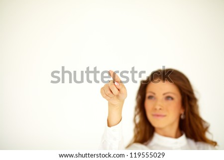 Young businesswoman press invisible button