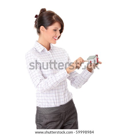 Young businesswoman  (real estate agent) with hose model and keys