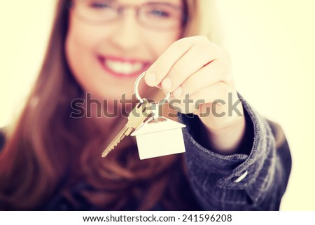 Young businesswoman ,real estate agent, with house keys in hand - stock photo