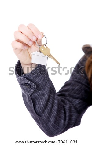 Young businesswoman (real estate agent) with house keys in hand - stock photo