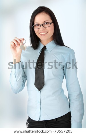 Young businesswoman  (real estate agent) with key - stock photo