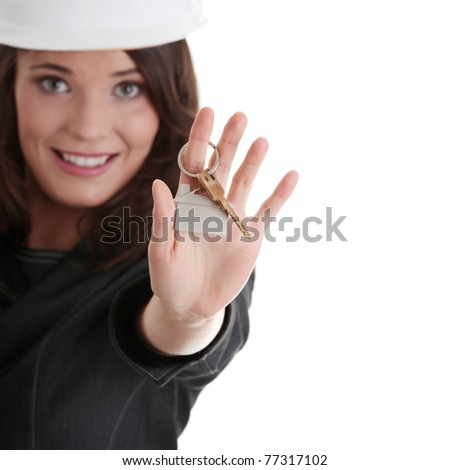 Young businesswoman (real estate agent) with keys - stock photo