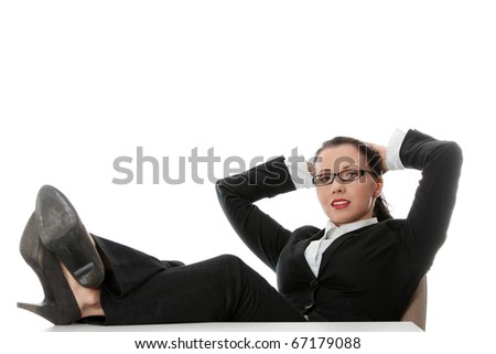 Young businesswoman relaxing at the desk, legs up, over white background