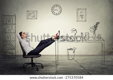 young businesswoman relaxing sitting in the office - stock photo