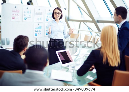 Young businesswoman reporting on business results of the financial period - stock photo