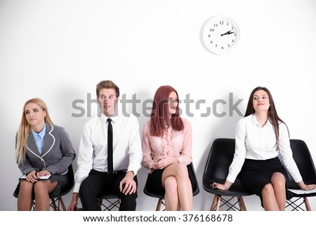 Young businesswoman reserving a seat in the queue