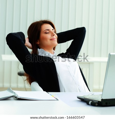 Young businesswoman resting in office