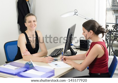 Young businesswoman sealing a deal - stock photo