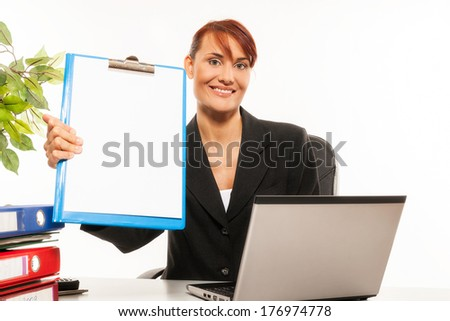 Young businesswoman showing a blank clipboard stands