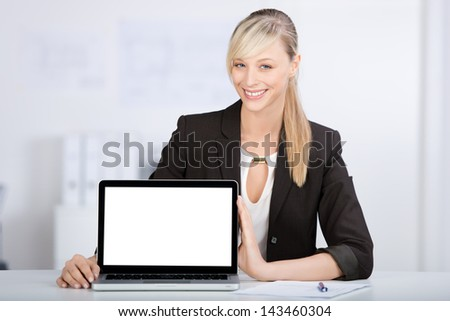 Young businesswoman showing a laptop over the white background