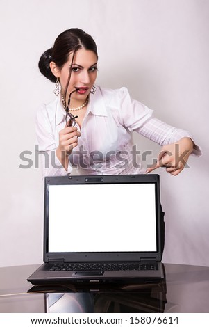 young businesswoman showing blank laptop screen - stock photo