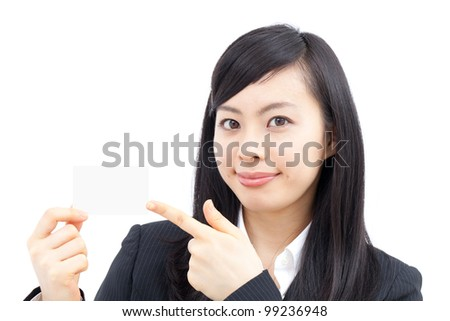 Young businesswoman showing business card - stock photo