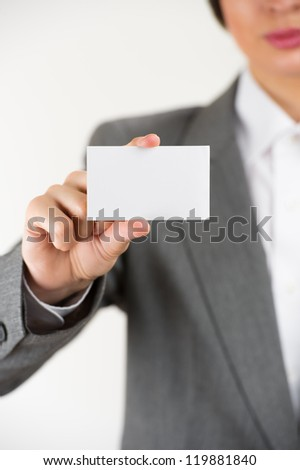 Young businesswoman showing her blank business card - stock photo