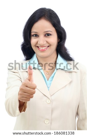 Young businesswoman showing thumbs up isolated against white background  - stock photo