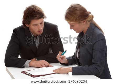 Young businesswoman signing a contract with a financial shark - stock photo