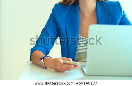 Young businesswoman sitting and talking on phone ..