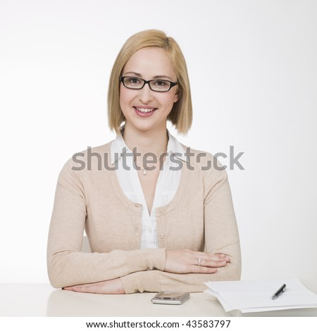 young businesswoman sitting at desk