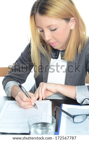 Young businesswoman sitting at desk with laptop isolated
