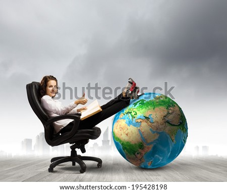 Young businesswoman sitting in chair and reading book. Elements of this image are furnished by NASA - stock photo