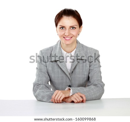 Young businesswoman sitting on the desk. Isolated on white background. - stock photo